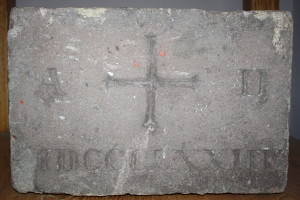 You can see this original cornerstone from St. Michael Parish in our church today.