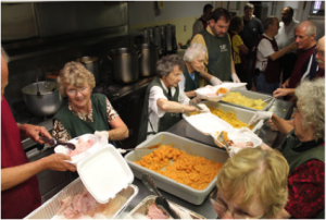 Volunteers help serve a welcome meal at St. John's Soup Kitchen.